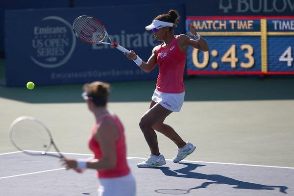 Raquel Kops-Jones smacks a shot as partner Abigail Spears looks on in their straight-set victory in the doubles final of the WTA's Southern California Open on Aug. 4 in Carlsbad.