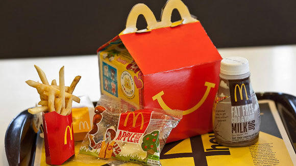 A McDonald's Happy Meal with chocolate milk and apple slices.