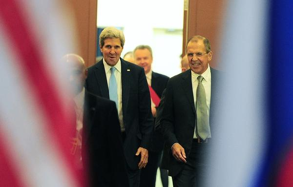 Secretary of State John Kerry (L) and Russian Foreign Minister Sergey Lavrov leave at the end of their bilateral meeting during the 68th United Nations General Assembly, in New York, September 24, 2013.