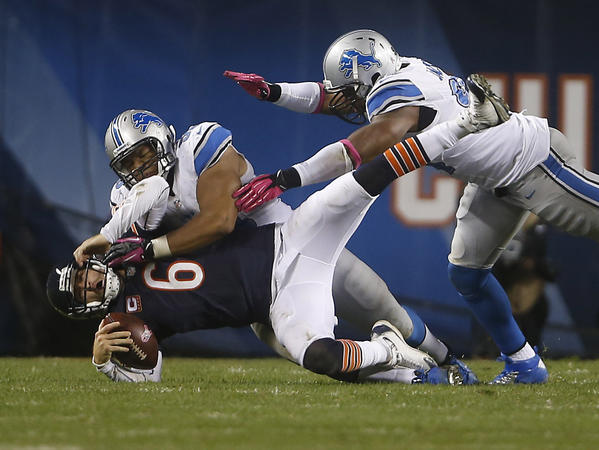 Bears quarterback Jay Cutler (left) is hit by Detroit Lions defensive tackle Ndamukong Suh in October 2012.