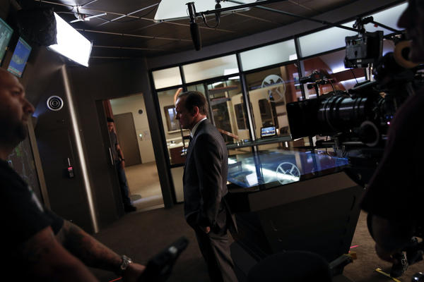 "ABC said men made up 54% of the audience for the pilot episode of ""Agents of S.H.I.E.L.D."" Above, Clark Gregg as agent Phil Coulson films a scene inside the show's command center."