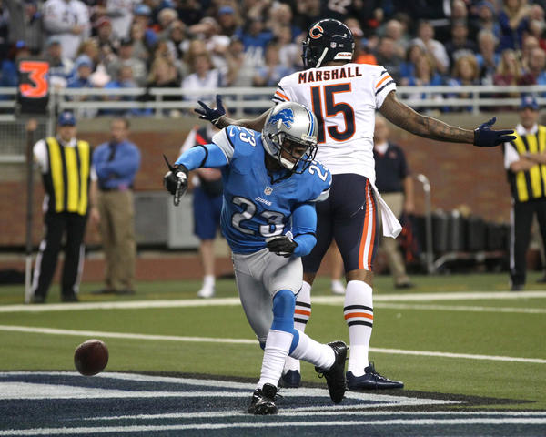 Detroit cornerback Chris Houston (front) celebrates after helping to break up a pass in the end zone intended for Bears receiver Brandon Marshall during the 2012 season.