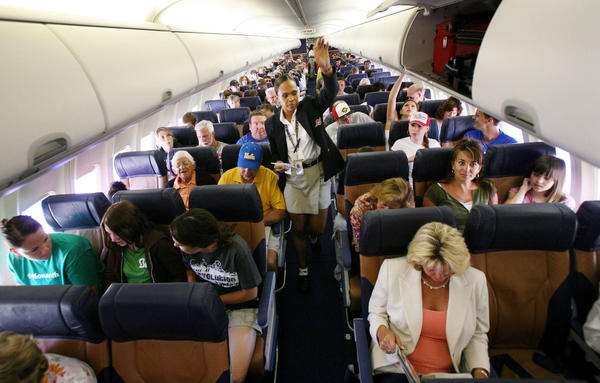 Passengers sit in their assigned seats before take-off.