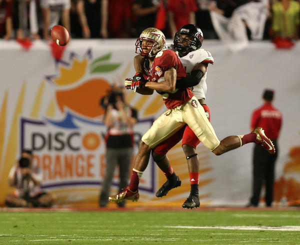 Northern Illinois defensive back Jimmie Ward breaks up a pass for Florida State's Rashad Greene in the 4th quarter.