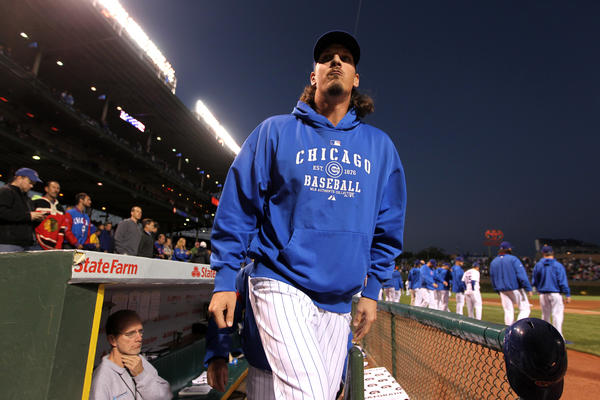 Jeff Samardzija walks out of the dugout before the start of a game against the Pirates at Wrigley Field.