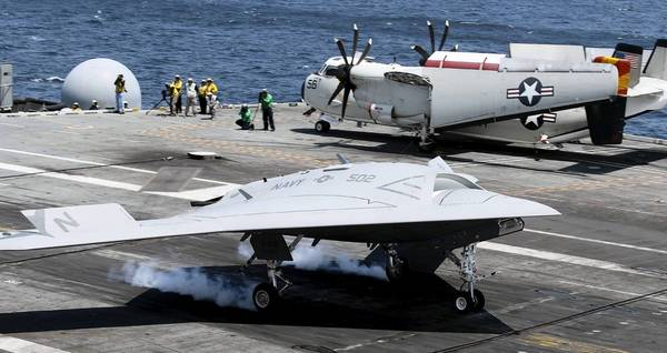 The unmanned aerial drone X-47B makes its first landing ever on the deck of the USS George Bush. The landing marked the first time an unmaned vehicle has landed on the deck of a carrier.