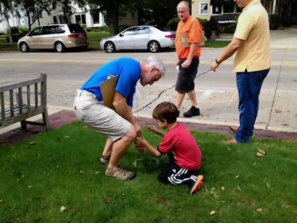 Jay Womack and Bennett McMillan, 4, mark the spot where a new tree will be planted, courtesy of funds raised by the Geneva Natural Resources Committee.