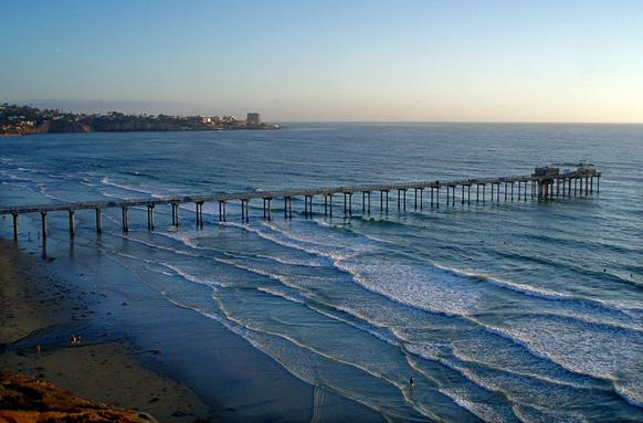 Scripps pier with La Jolla Cove in background.