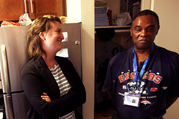 U.S. Air Force veteran Willie Edward, 55, right, enjoys a visit from Hillary Evans, assistant director for permanent supportive housing with New Directions for Veterans. He's seen in his new apartment at the Sepulveda VA in North Hills.