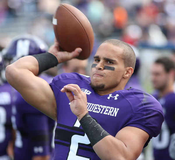 Northwestern's Kain Colter is wearing his feelings about paying college players on his wrists.