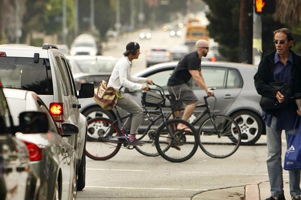 Cyclists at the intersection of Bundy Drive and Idaho Avenue in West Los Angeles.