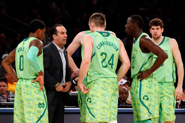 Notre Dame coach Mike Brey talks with his players during an NCAA tournament game.