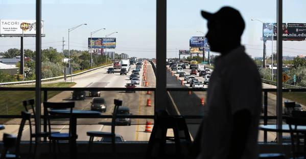 Travelers pass through the Des Plaines Oasis overlooking the Jane Addams Memorial Tollway (Interstate 90). The oasis will close in April to allow for more lanes along I-90.