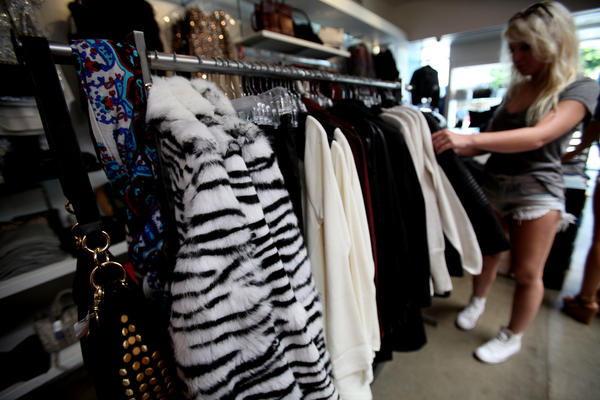 A shopper goes through the inventory at Kitson, the trendy Los Angeles clothing store, Sept. 17, 2013. West Hollywood's ban on fur apparel, which took effect Saturday, is now the subject of a lawsuit.