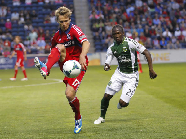 Chris Rolfe is pursued by Timbers midfielder Diego Chara during the first half at Toyota Park.
