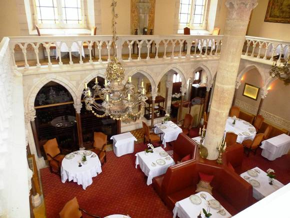The dining room in the restored Abbaye de la Bussierea¿ hotel in Burgundy