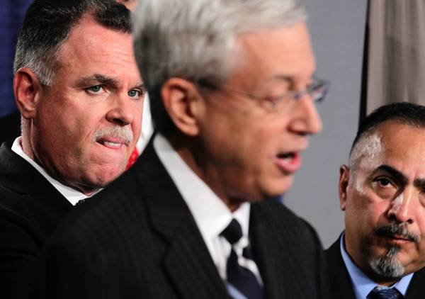 Acting U.S. Attorney Gary Shapiro, center, is joined by Chicago Police Supt. Garry McCarthy, left, Thursday as he announces federal racketeering charges filed against nine alleged leaders of the Hobos street gang.