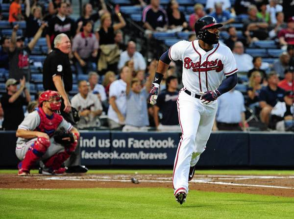 Jason Heyward of the Braves hits a lead-off home run against the Phillies at Turner Field on Thursday night.
