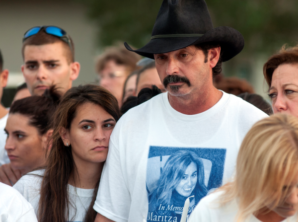 Damarys Medina, left and her father Diego Medina attend a vigil for Maritza Medina outside the Southwest Ranches town council meeting Thursday night.