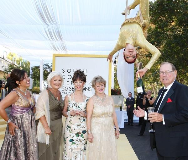 Yvonne Jordan, Sophie Cripe, Julianne Argyros, Bette Aitken and George Argyros with a Taittinger Champagne aerialist at SCR's 50th Anniversary Gala.