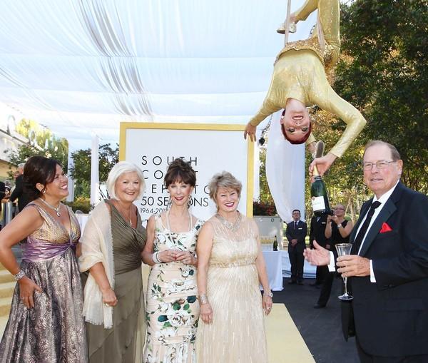 Yvonne Jordan, Sophie Cripe, Julianne Argyros, Bette Aitken and George Argyros with a Taittinger Champagne aerialist at SCR's 50th Anniversary Gala.