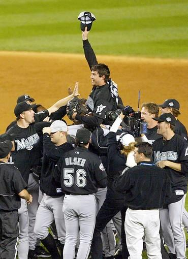 """In the clubhouse before working out in Yankee Stadium, several Marlins watched their adopted movie, """"Old School."""" Miguel Cabrera was nicknamed, """"Blue"""" after the old-man character. That's typified, to me, what a fun run this was. And what a team to write about. I went to mass with Jack McKeon, who left his cigar on a post outside and picked it up, still smoking, on the way out. I stood there in Wrigley Field when Steve Bartman was ushered by protective security guards to a holding room so irate fans couldn't get at him. Then there was the climactic moment, Josh Beckett shutting down New York to win the World Series in Yankee Stadium. Marlins owner Jeffrey Loria then ran the bases in an empty stadium and slid head-first into home plate. For the surprise and the title, it was the sports story of our decade."""