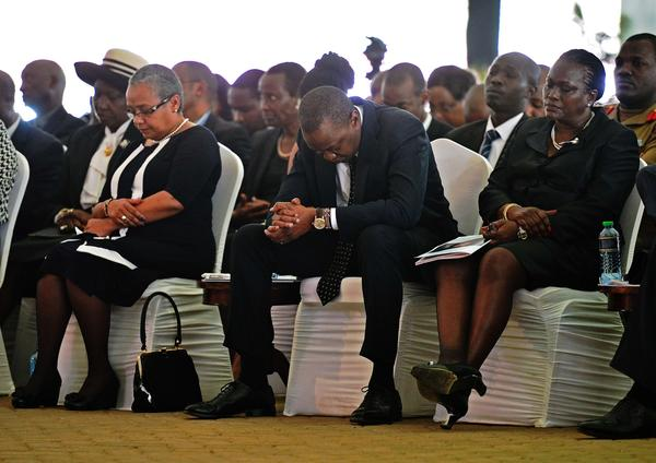 Kenyan President Uhuru Kenyatta prays during a funeral service for his nephew Mbugua Mwangi and his fiancee, Rosemary Wahito, in Nairobi on Friday. Both died in the Westgate Mall terrorist attack.