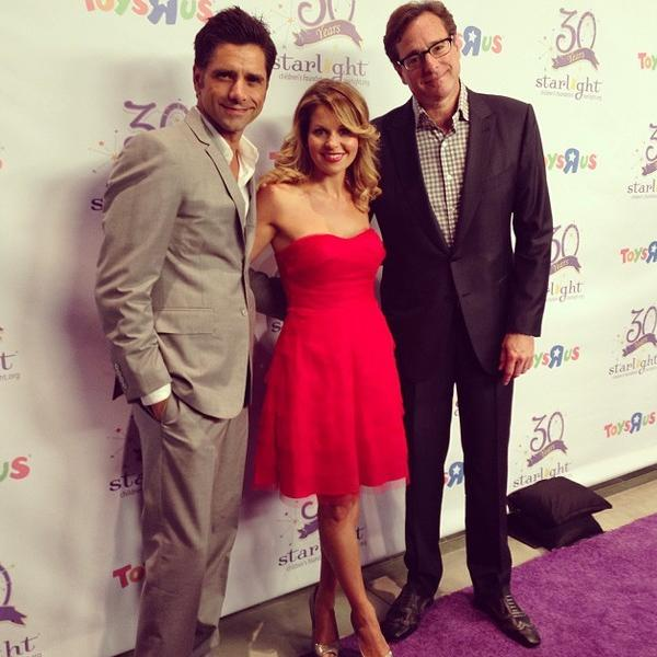"Candace Cameron Bure of ""Full House"" reunites with former costars John Stamos, left, and Bob Saget at a Starlight Foundation charity event."