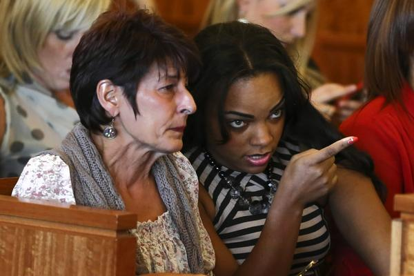 Shayanna Jenkins (right), fiancee of Aaron Hernandez, talks with Hernandez's mother, Terri , during Hernandez's arraignment in the Bristol County Superior Court in Fall River, Massachusetts September 6. (Reuters)
