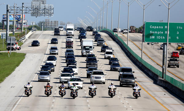 Traffic resume along I95 behind the Funeral procession for BSO deputy Daniel Rivera who died in a crash along I-95 in Pompano Beach Sept. 11 while on his way to work.