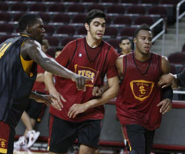 At 7-foot-2, center Omar Oraby, center, is the tallest player on USC's team this season.