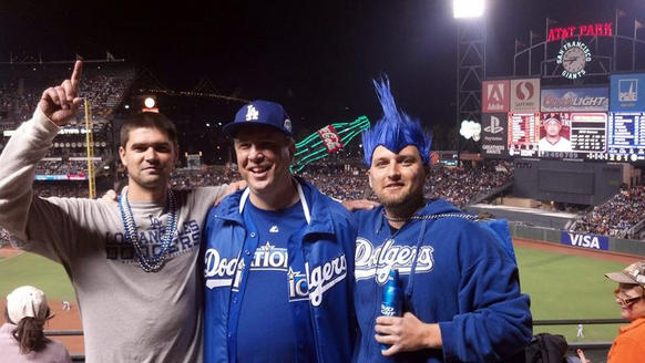 This photo, taken Sept. 25 and provided by Matthew Gomes, shows, from left to right, Jonathan Denver, his father, Robert Preece, and his brother Rob Preece at a baseball game between the San Francisco Giants and the Los Angeles Dodgers in San Francisco.