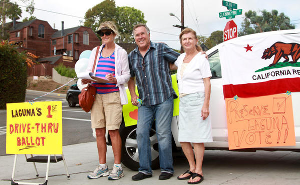 Paul Merritt, center, started a petition to gather enough signatures for the Village Entrance project to be included on a future ballot. Laguna Beach resident Rosemary Seaney, far right, is opposed to a parking structure, which is included in the Village Entrance proposal.