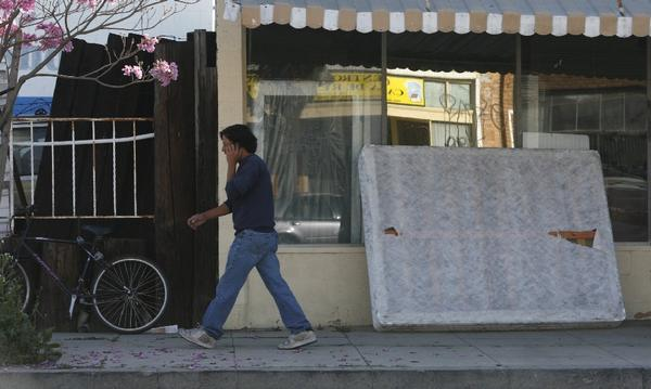 Gov. Jerry Brown has signed a mattress recycling bill into law. Above, a mattress dumped in front of a Wilmington store.