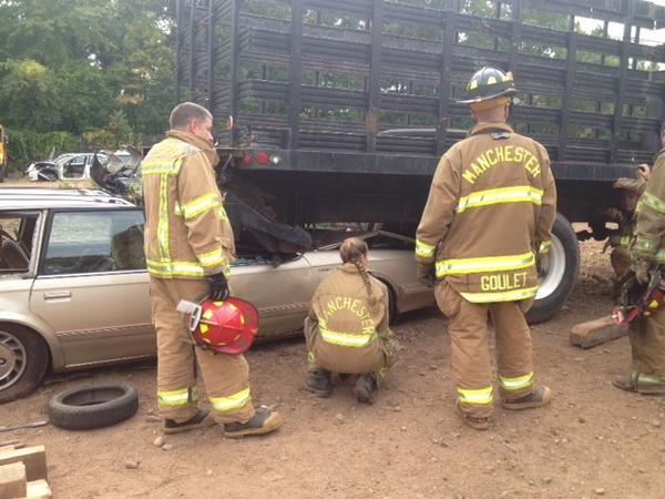 Firefighters at a vehicle rescue training course at Parker Street Auto.