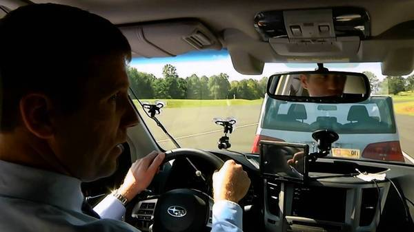 David Zuby of the Insurance Institute for Highway Safety drives a Subaru Outback equipped with the EyeSight collision-avoidance system during a test.