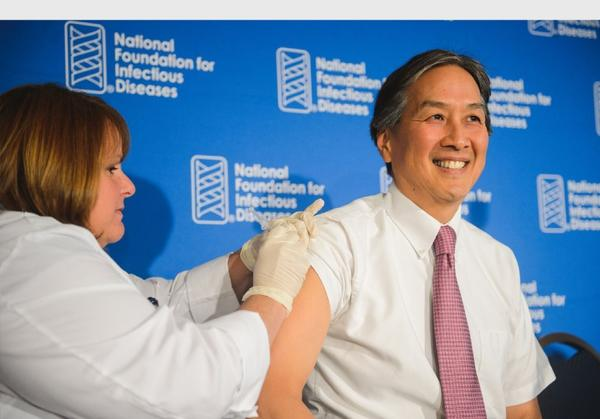 Setting a good example, Dr. Howard K. Koh, assistant secretary for health at the U.S. Department of Health and Human Services, follows the CDC's advice and gets a flu shot on Thursday.