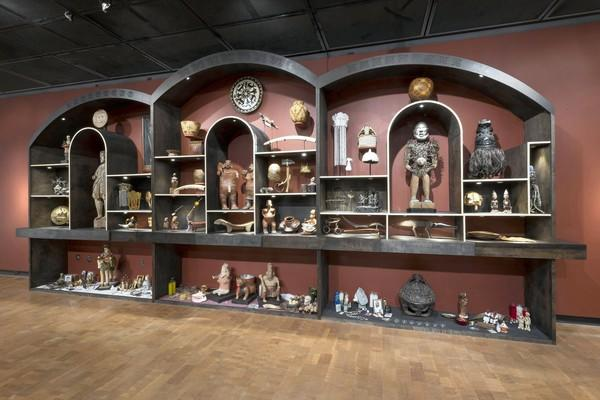"""New World Wunderkammer,"" with items picked by Amalia Mesa-Bains, has cabinets showcasing Africa, the indigenous Americas and a mix of New World cultures."