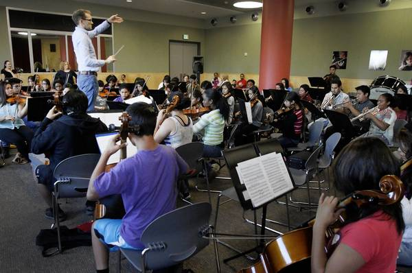Bruce Kiesling conducts Youth Orchestra Los Angeles at the Expo Center in Exposition Park in Los Angeles on Sept. 18, 2013. (Lawrence K. Ho / Los Angeles Times)
