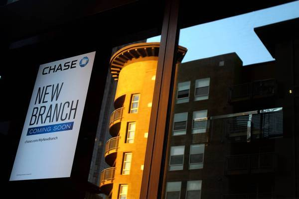 Some in the condos at 1100 Wilshire Blvd., including those in the penthouse, are unhappy that a deal was made with Chase to put its name on the building for $17,500 a month.