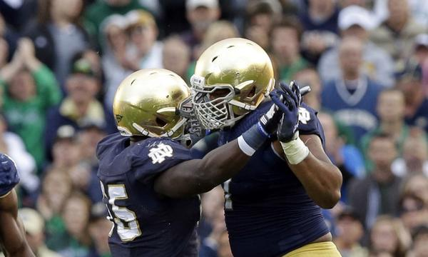 Notre Dame defensive linemen Prince Shembo, left, and Stephon Tuitt celebrate a sack in a win over Michigan State last week. Will the Fighting Irish pull off a win Saturday against Oklahoma?
