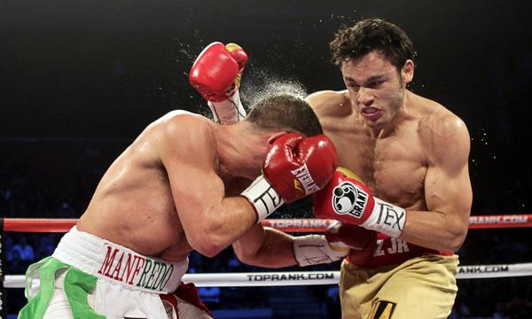 Julio Cesar Chavez Jr., right, connects with a glancing blow during his victory over Peter Manfredo Jr. in 2011. Chavez Jr. will try to get back on the winning track with a victory Saturday night over Brian Vera.
