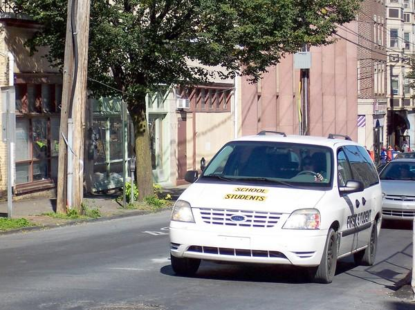 Vehicles such as this one on Linden Street in Allentown are classified by state law as school vehicles and do not qualify as school buses.