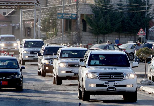 A convoy carrying U.N. chemical weapons inspectors crosses into Lebanon from Syria last month.