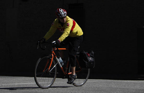 A cyclist makes his way on Polk Street in San Francisco. The new three-foot rule requiring passing motorists to keep a safe distance from cyclists, signed into law by Gov. Jerry Brown on Sept. 23, takes effect in about a year.
