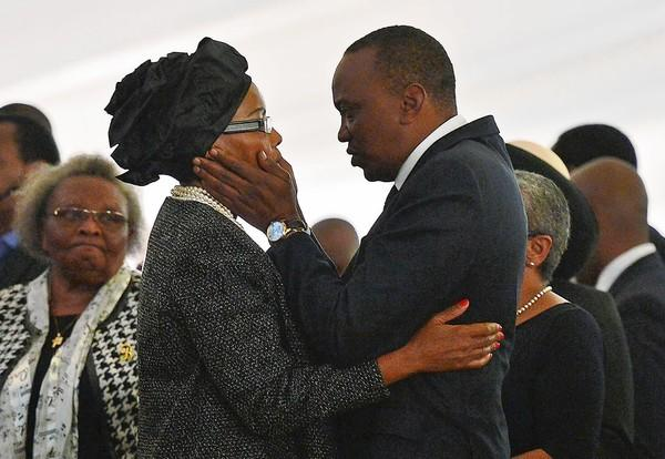 Kenyan President Uhuru Kenyatta comforts his sister Catherine Mwangi at the funeral of her son and her son's fiancee. Both were killed in the terrorist attack on the Westgate shopping mall in Nairobi. News reports have raised questions of whether some security units went into the mall on a mission to save a group of VIPs.