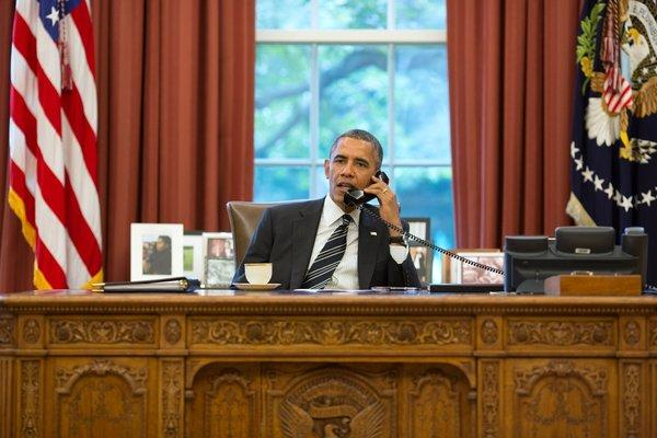 President Obama speaks with President Hassan Rouhani of Iran during a phone call from the Oval Office on Friday.