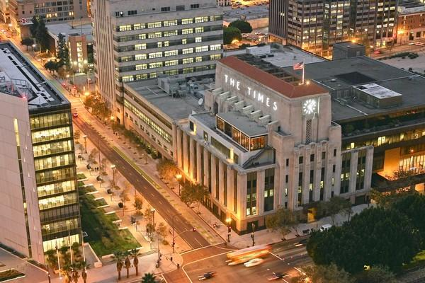 The Los Angeles Times headquarters is seen from the observation deck of Los Angeles City Hall. Tribune Co., parent of The Times, is examining its operations in an effort that is likely to result in staff reductions at the company's daily newspapers.