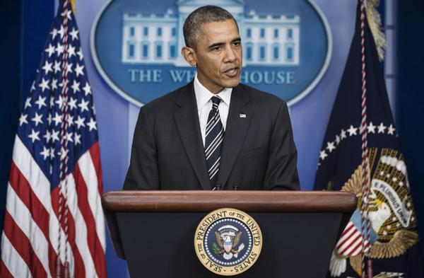 President Barack Obama speaks to members of the press in the briefing room of the White House on Friday about a phone conversation he had with Iranian President Hassan Rouhani and a looming government shutdown as the U.S. Congress debates government funding.