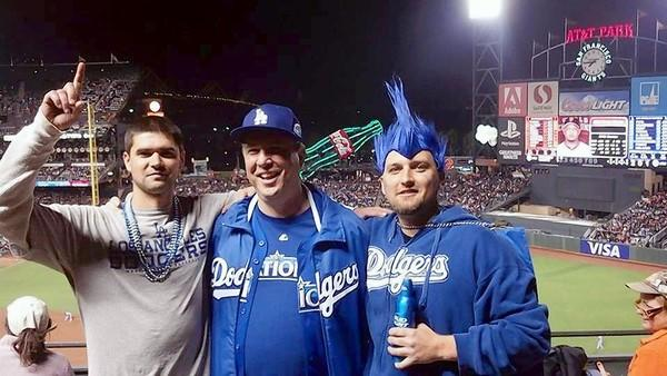 Jonathan Denver, left, his father, Robert Preece, and his brother, Rob Preece, are shown at the game between the San Francisco Giants and the Los Angeles Dodgers on Wednesday. Denver died in a confrontation after the game.